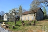 Farmhouse with large outbuildings on almost 7 acres Ref # Li675
