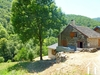 Pretty stone house approx. 110m², renovated, patio and land sloping down to the river totalling appr Ref # MPPDJ032