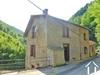 Imposing riverside house in a quiet mountain hameau, needs updating near Massat. Ref # MPPDJ037