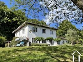 Stately modern villa with parkland bordering a stream