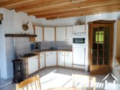 fully equipped kitchen with Godin woodburner