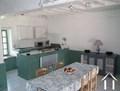 House with 6 rental units and pool in burgundy countryside Ref # MP5066V image 8 Kitchen in downstairs apartment of Farmhouse