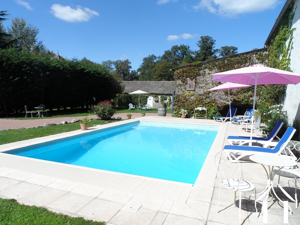 Character house for sale ciel burgundy 9065 for Heated pools for sale