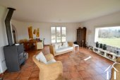 large living room of 44m2, with panoramic window dominating garden and view