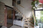 stairs to first floor, in veranda area