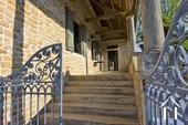 stone steps to the enclosed Maconnais balcony