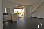 Low maintenance home with terrace and views Ref # JP4961S image 2 living room with practical corner kitchen