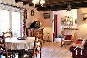 Lovely renovated farmhouse with holiday home on an acre Ref # AH4876B image 14 large living dining room in the guest house