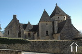 Castle XIII c. in middle of little village in the Dordogne Ref # GVS4944C image 2