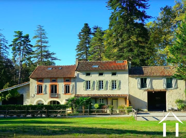 Large renovated French farmhouse (600m2) split in to three separate dwellings with swimming pool & outbuildings. Set in 3 hectares of mature gardens. Ref # MPOP0063