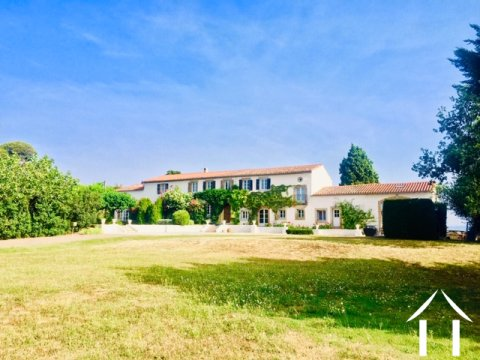 Spacious French farmhouse (450m2) consisting of 2 adjoining houses on 24,400m2 of land and heated swimming pool Ref # MPOP0072